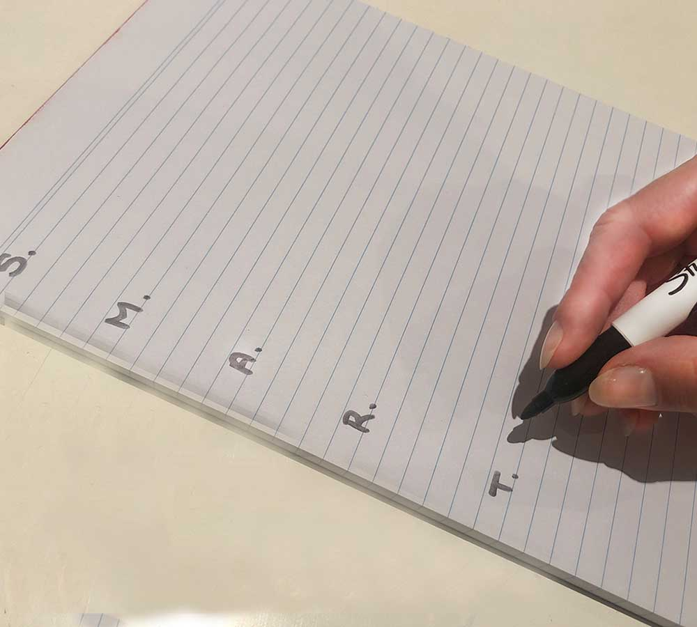 SMART goal writing example on paper