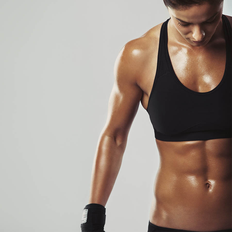 A strong woman sweating after a workout