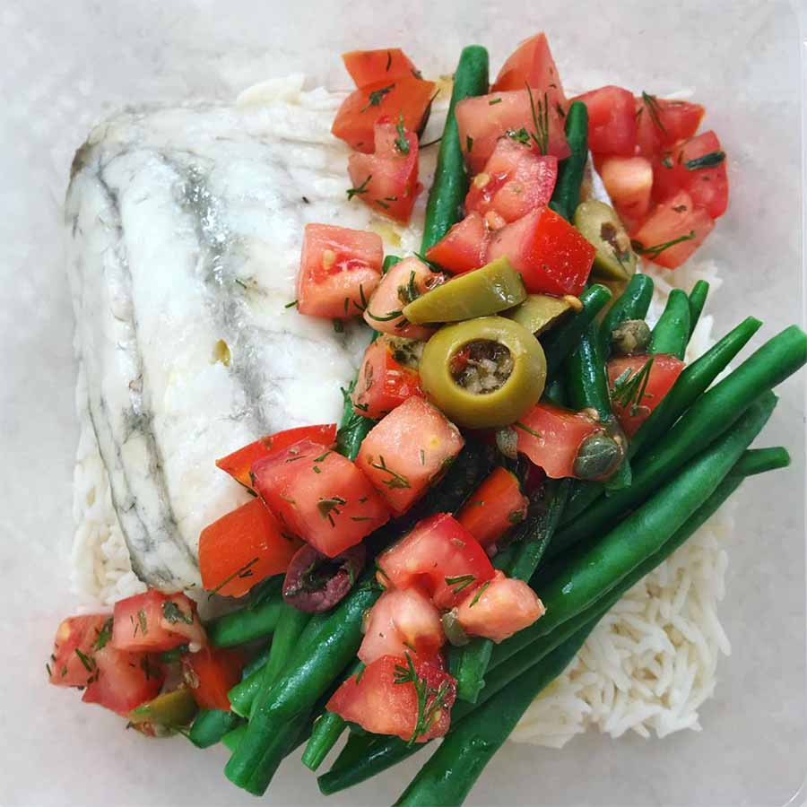 fish and vegetables laid on rice