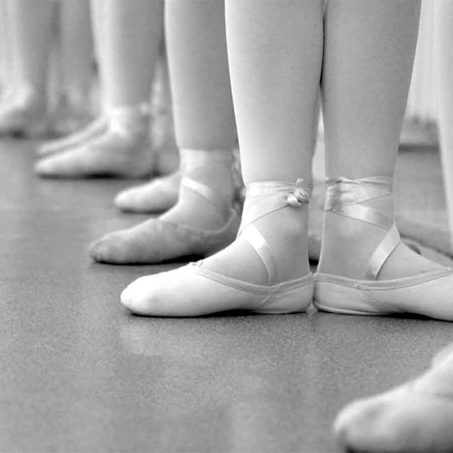 A row of ballerina feet in black and white